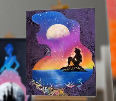 La Sirenetta- Immagine de La Sirenetta che pensa, seduta su di uno scoglio- Wolf Art